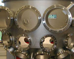 Integrated water cooling for vacuum chambers