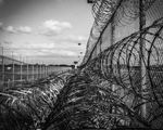 Privately operated prisons us ending barb wire